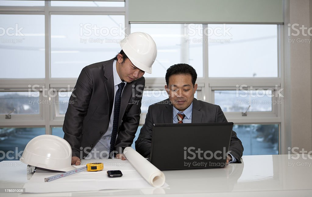 Architects working on planning royalty-free stock photo