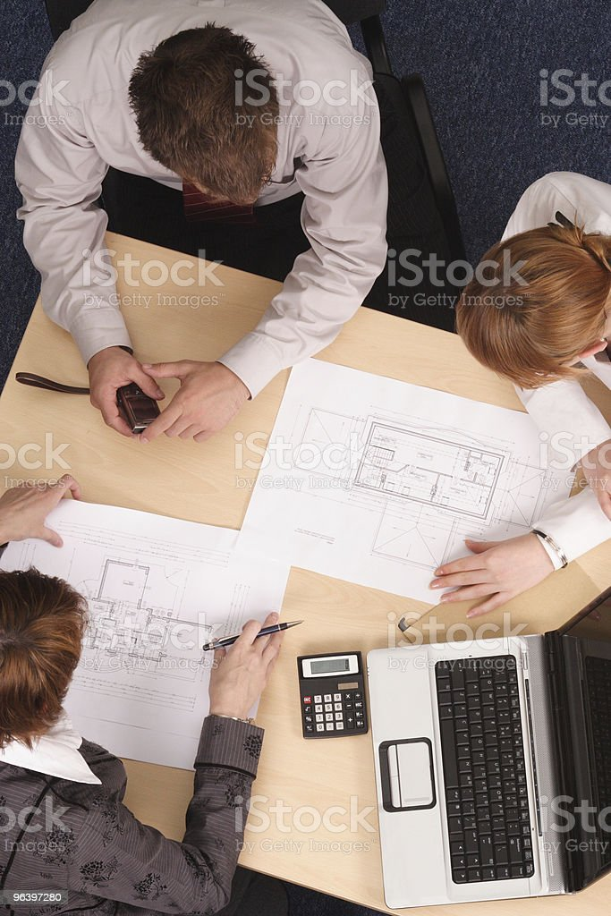 architects working with blueprints royalty-free stock photo