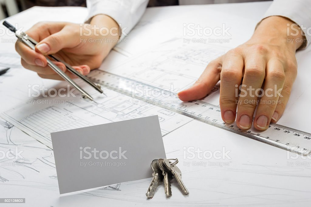 Architects workplace blueprints keys business card construction real architects workplace blueprints keys business card construction real estate concept royalty malvernweather Images