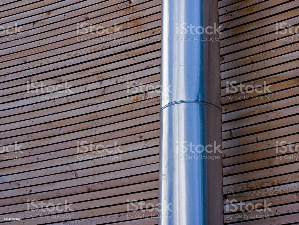 Architectural Abstract: Metal Chimney on Wooden Wall royalty-free stock photo