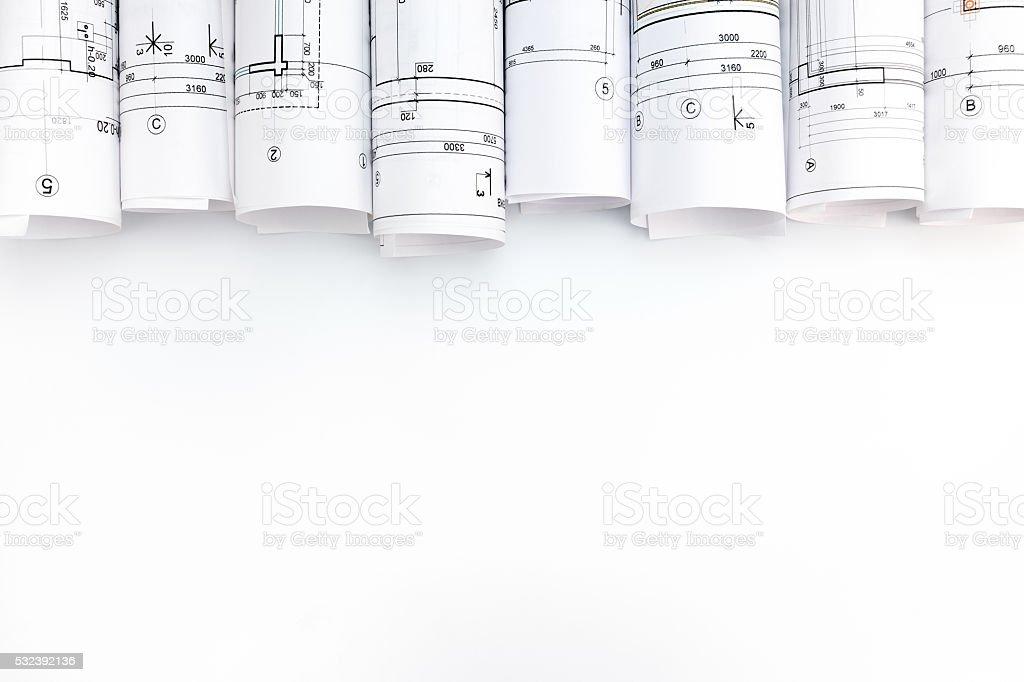 architectural blueprint rolls on white background stock photo