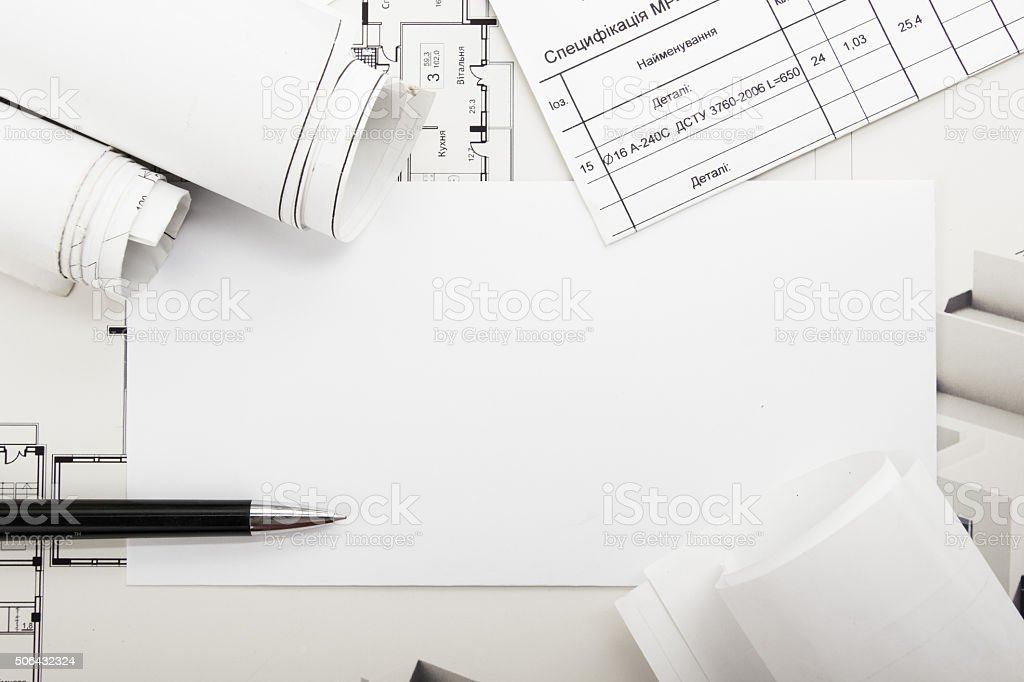 Architectural blueprints and blueprint rolls on white background. stock photo