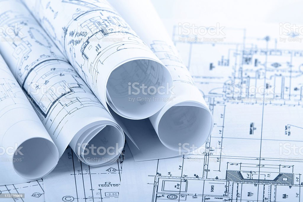 Architectural blueprints and blueprint rolls royalty-free stock photo