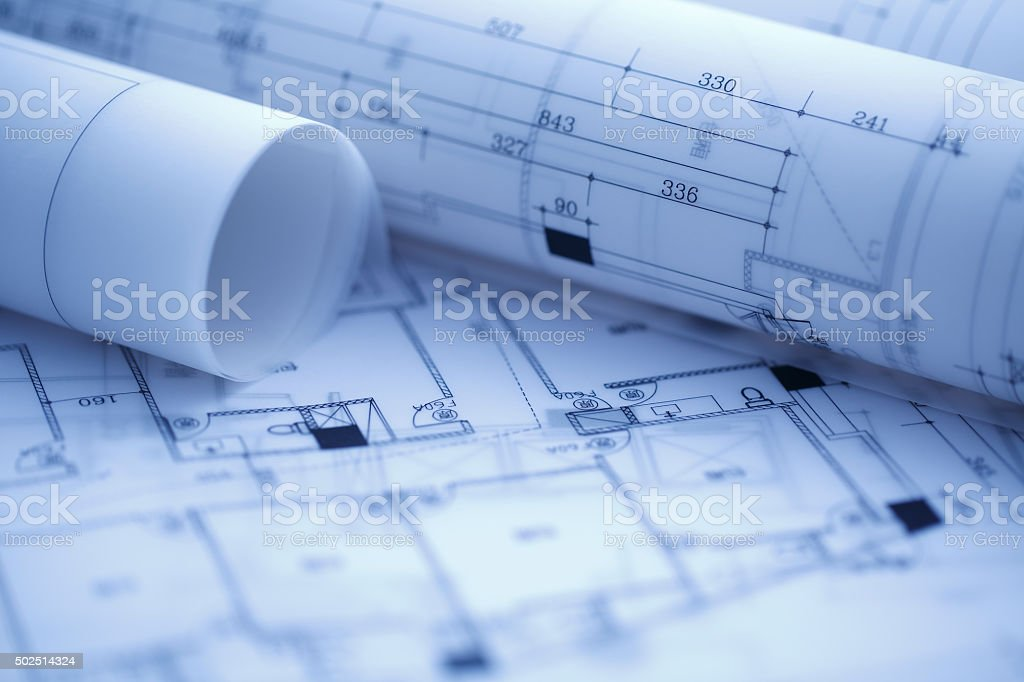 Architectural blueprints and blueprint rolls stock photo