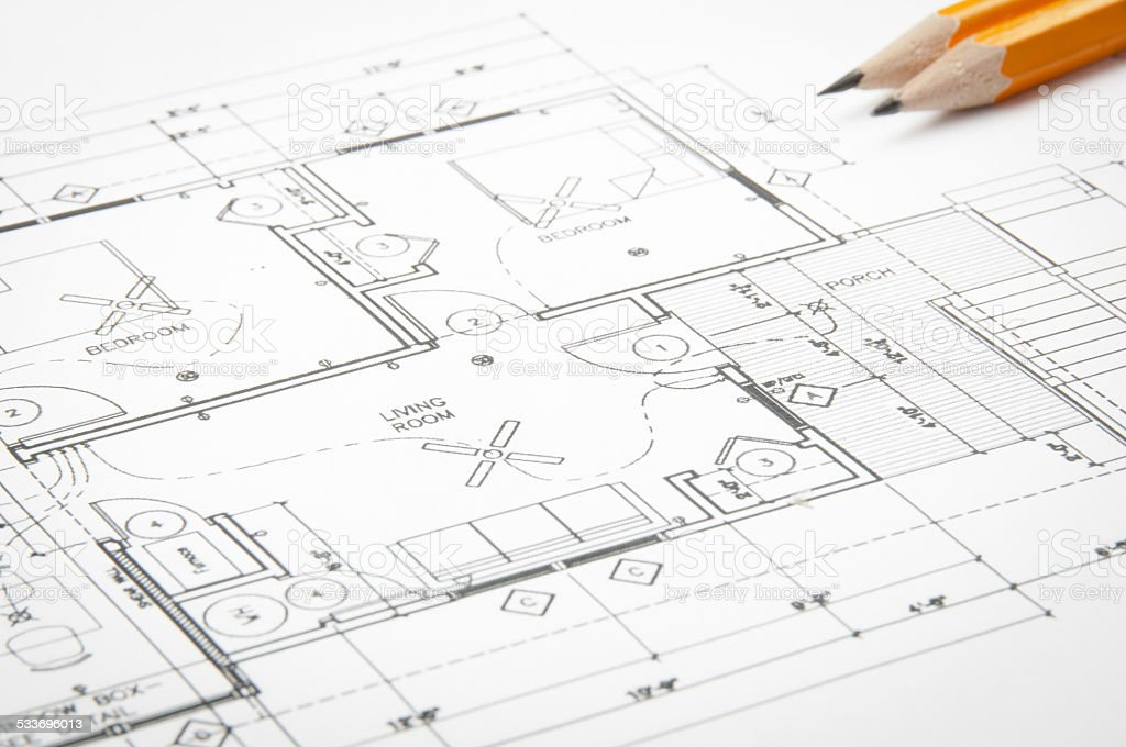 architectural blueprints and blueprint rolls with drawing