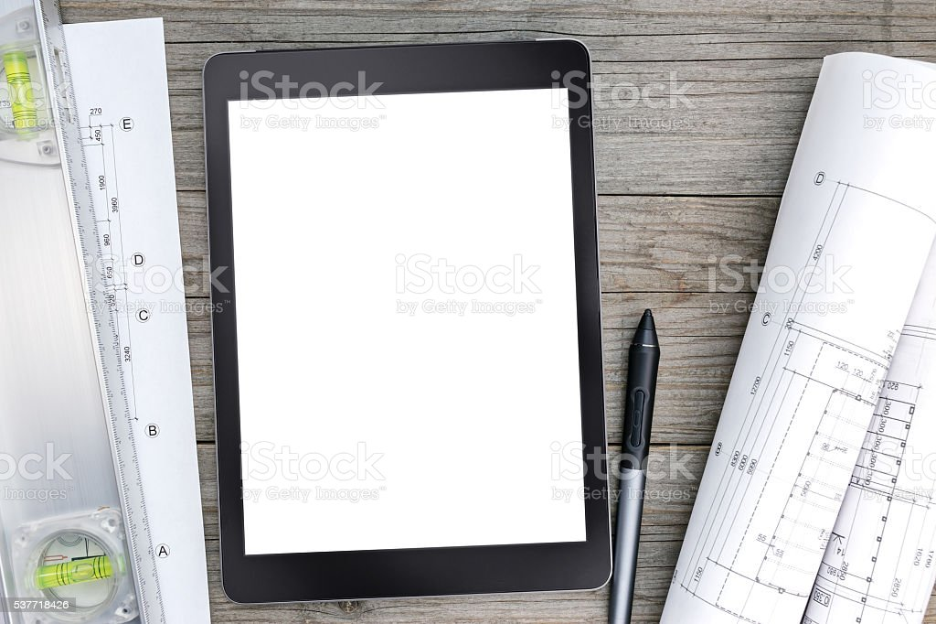 architectural blueprints with spirit level and digital tablet stock photo