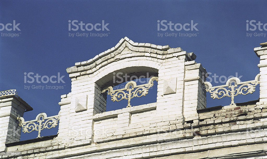 Architectural detail above the cornice of  building. royalty-free stock photo