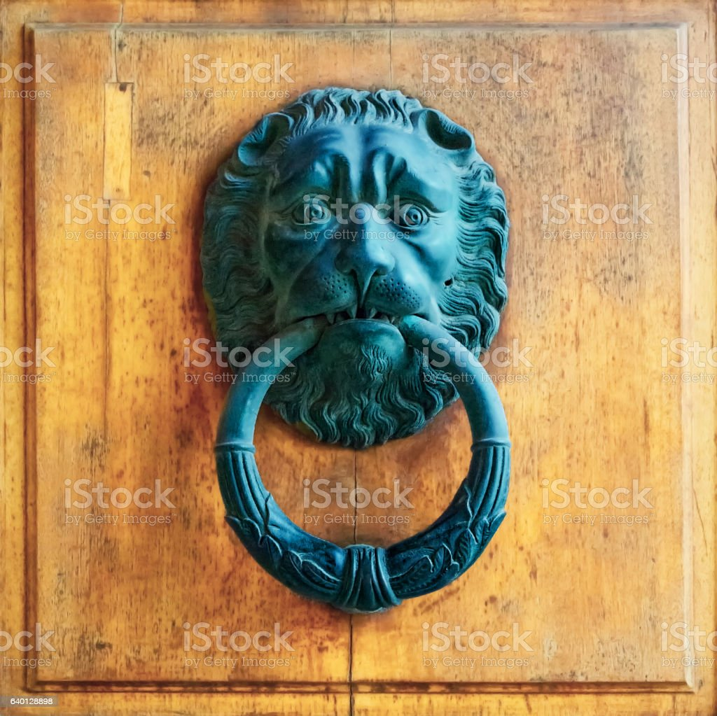 Architectural details -ancient door knoker with lion stock photo