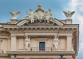Architectural details of a building in Rome with Olympic Gods