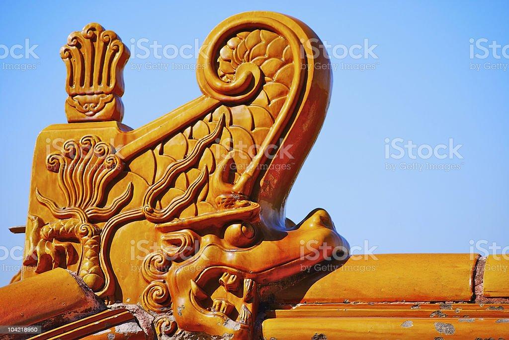 Architectural details of yellow glazed dragon tile stock photo