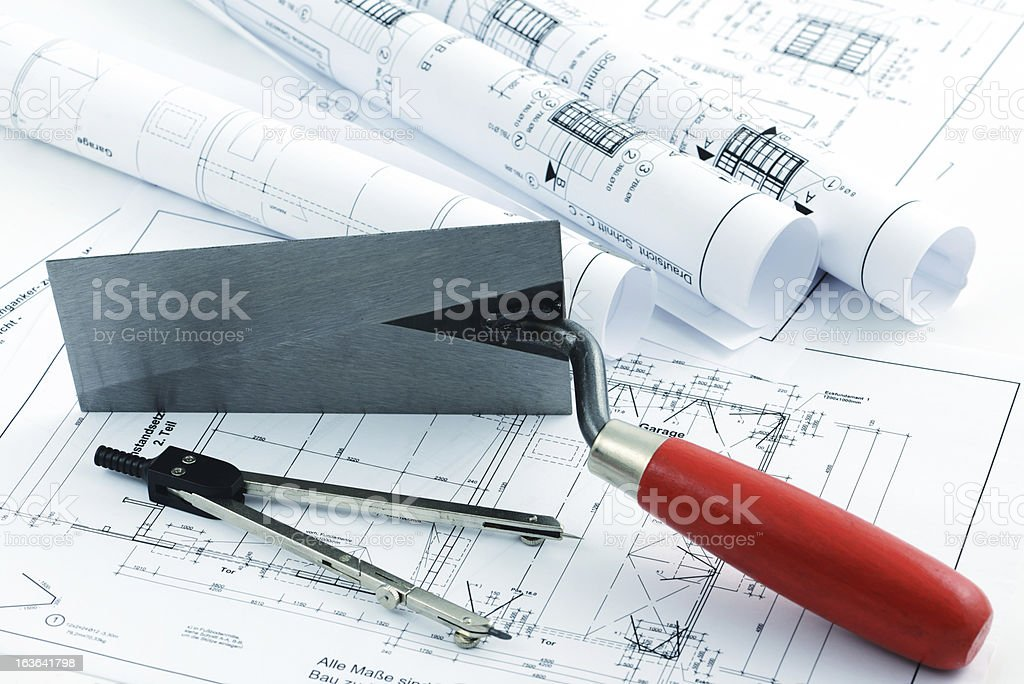 architectural drawing blueprint with a trowel and compass royalty-free stock photo