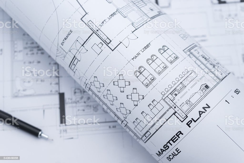 architectural drawing paper rolls of a dwelling for construction stock photo