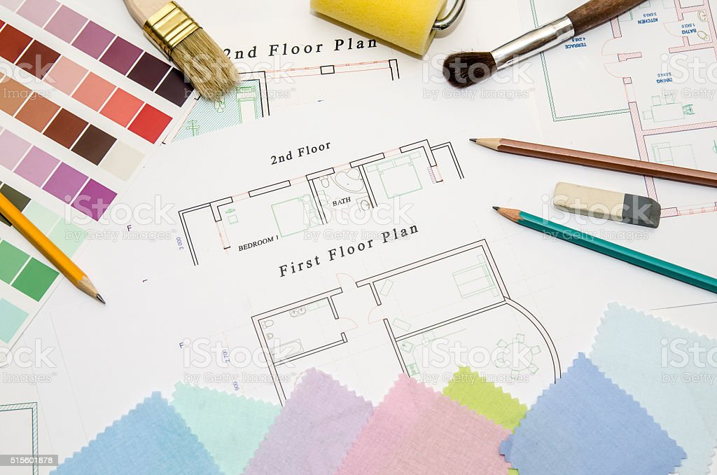 architectural drawing with paintbrush, color sample and working tools stock photo