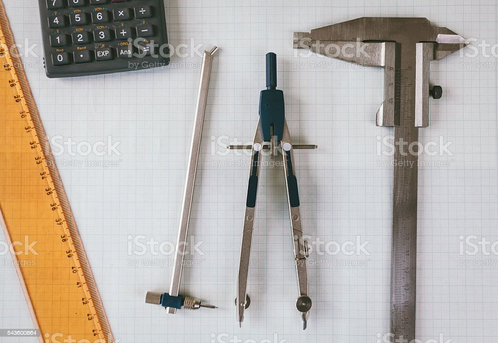 Architectural equipment on graph paper stock photo