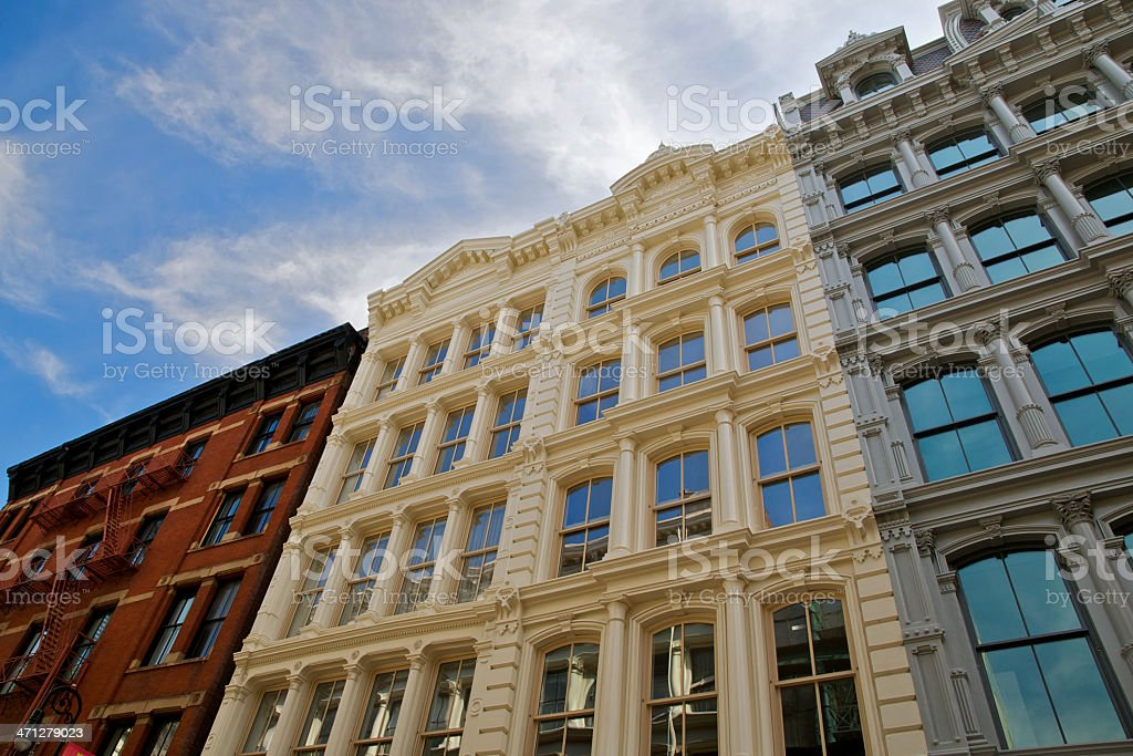 NYC Architectural eras in contrast, Soho cast-iron buildings stock photo