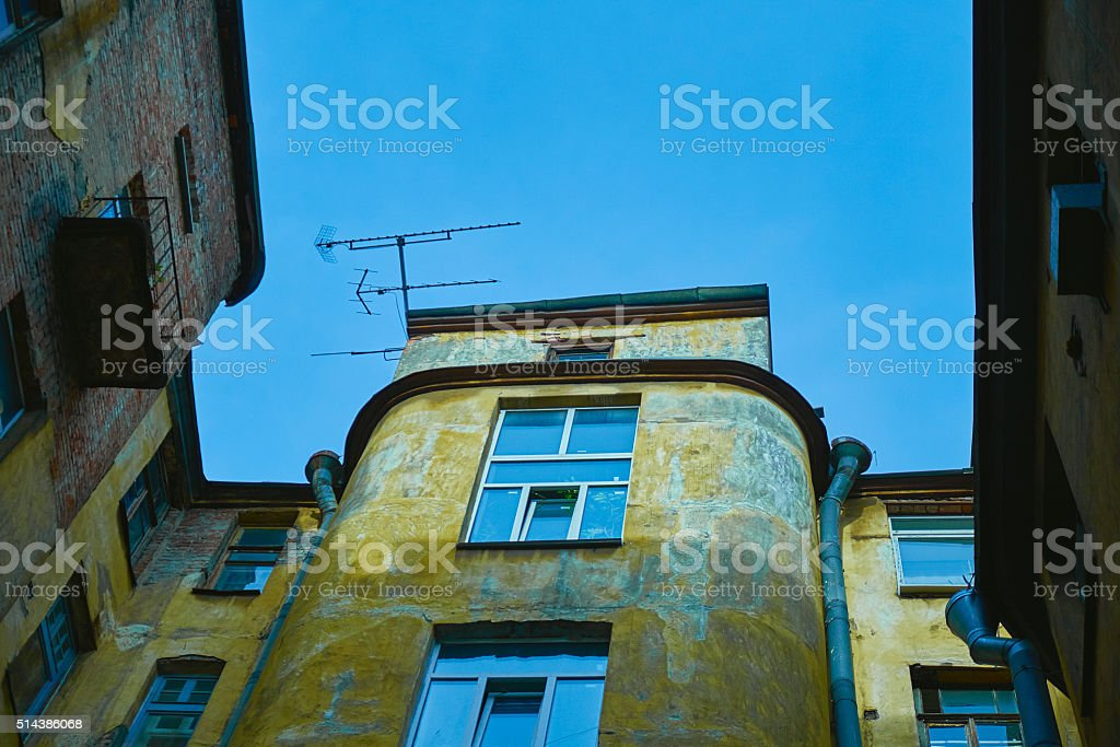 Architectural fragment courtyard-well of apartment old house in perspective stock photo