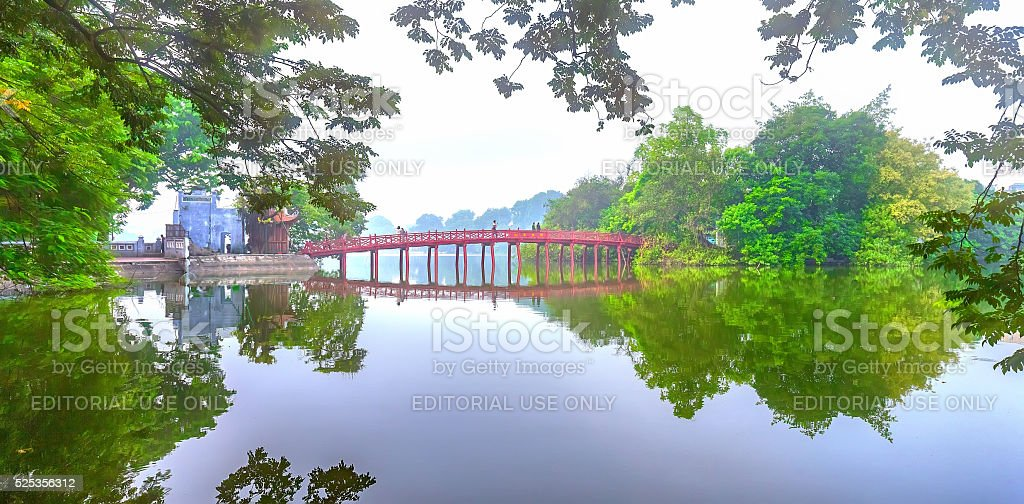 Architectural Huc Bridge looming shake trees lake stock photo