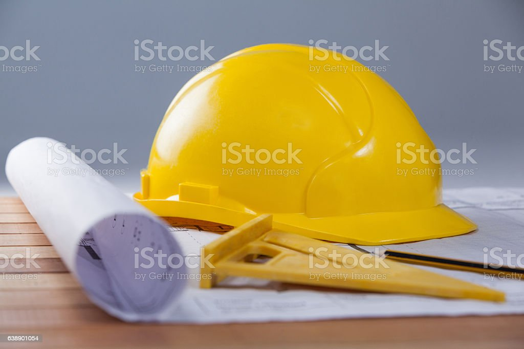 Architectural plan with tools and hard hat stock photo