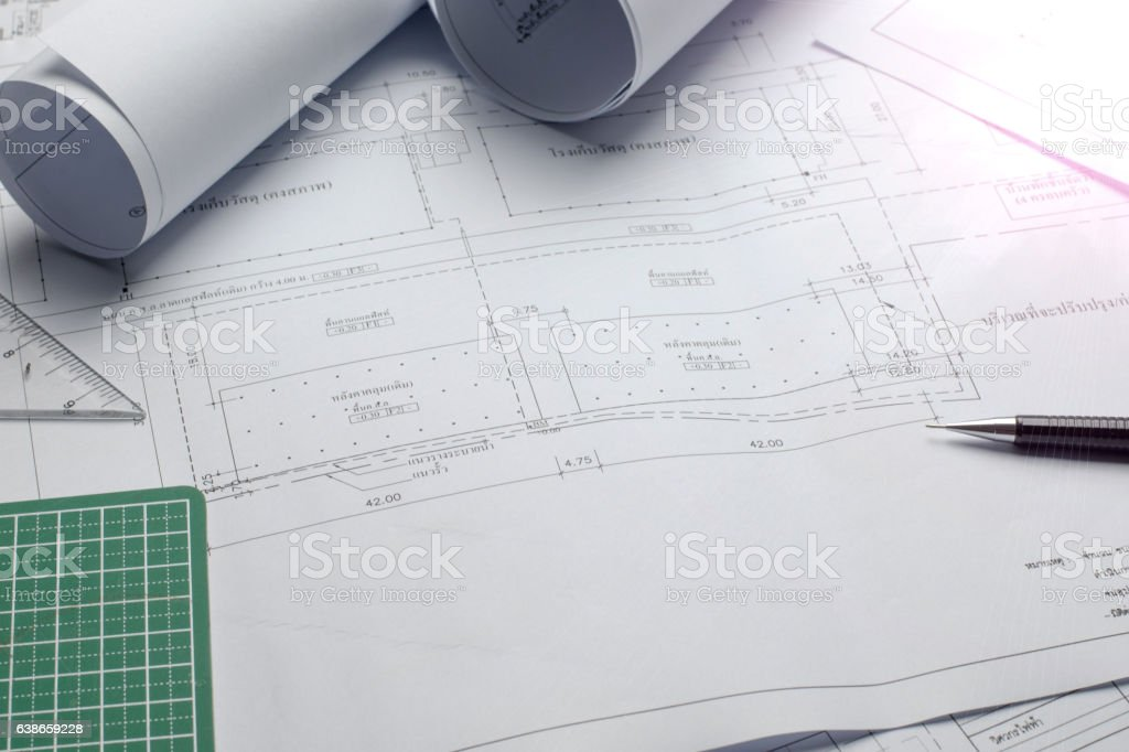 architectural plans project drawing with blueprints rolls stock photo