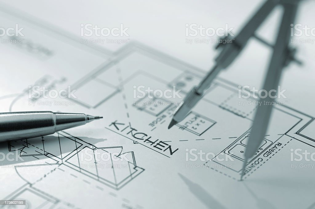 Architectural plans with compass and pencil royalty-free stock photo