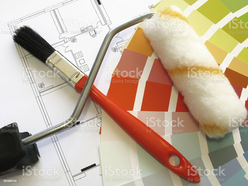 Architectural plans with paint brush, roller and swatches royalty-free stock photo