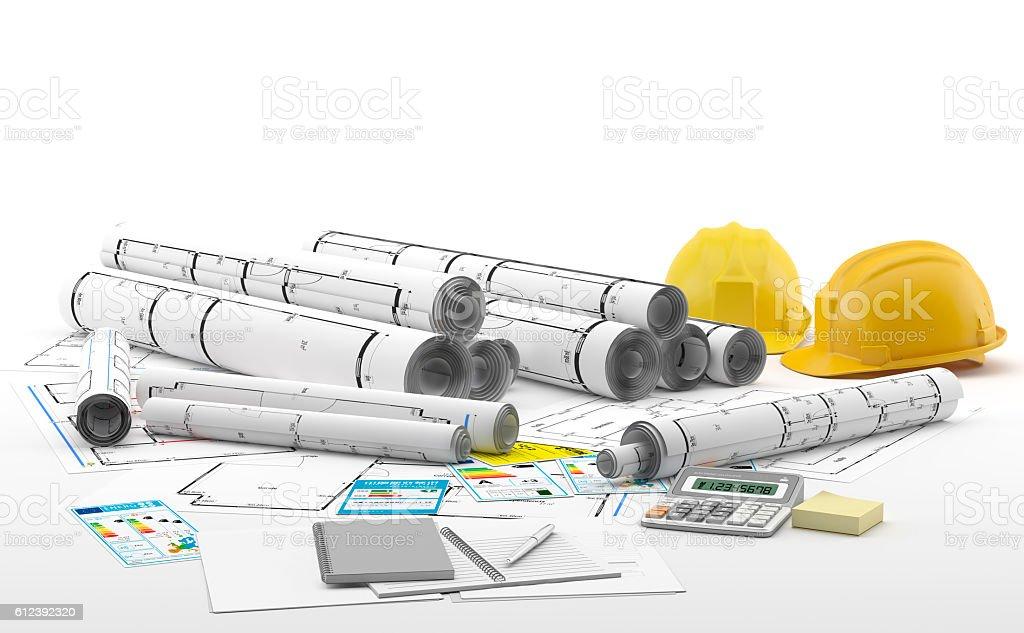 Planos de arquitectura con dos cascos amarillos. stock photo