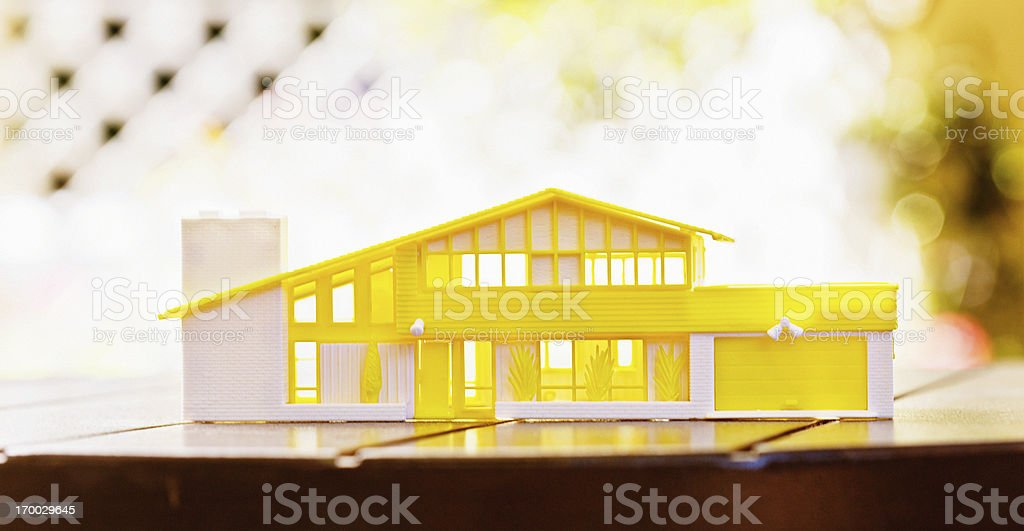 Architectural plastic model of ideal home on outdoor table royalty-free stock photo