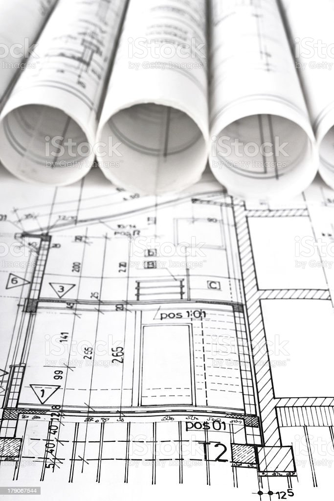 architectural project and blueprints rolls stock photo