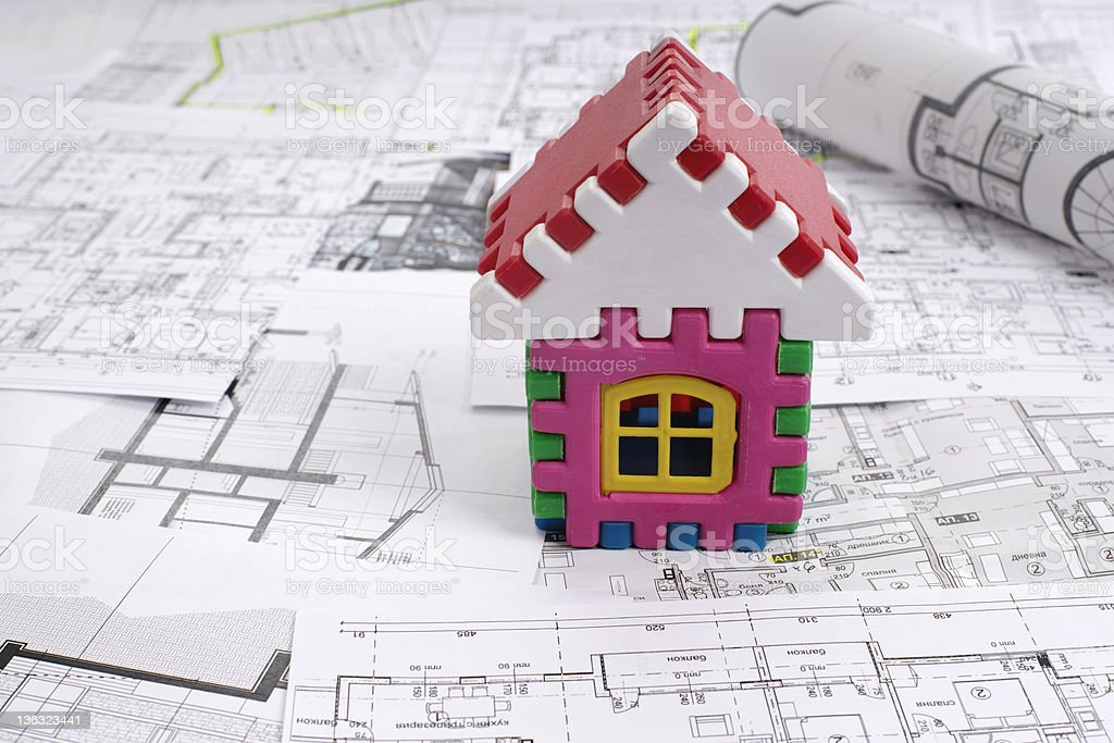 Architectural project and  toy house royalty-free stock photo