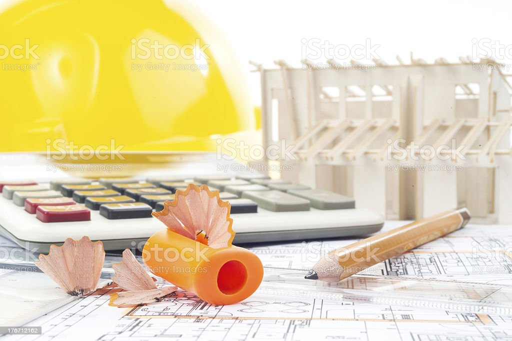 Architectural project, pencils, pencil sharpener, calculator, model and yellow helmet royalty-free stock photo