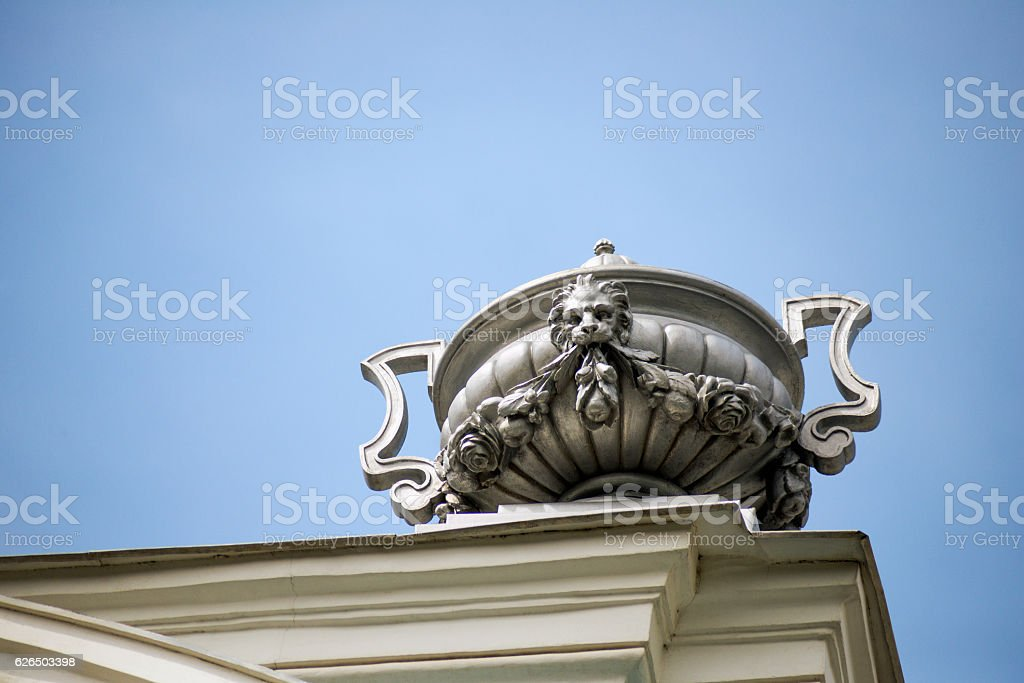 Architectural vase on the roof of the old building. stock photo