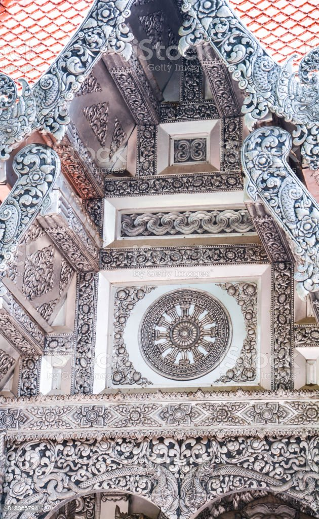 Architecture and sculpture carved metal temple high tall decorative lanna stock photo