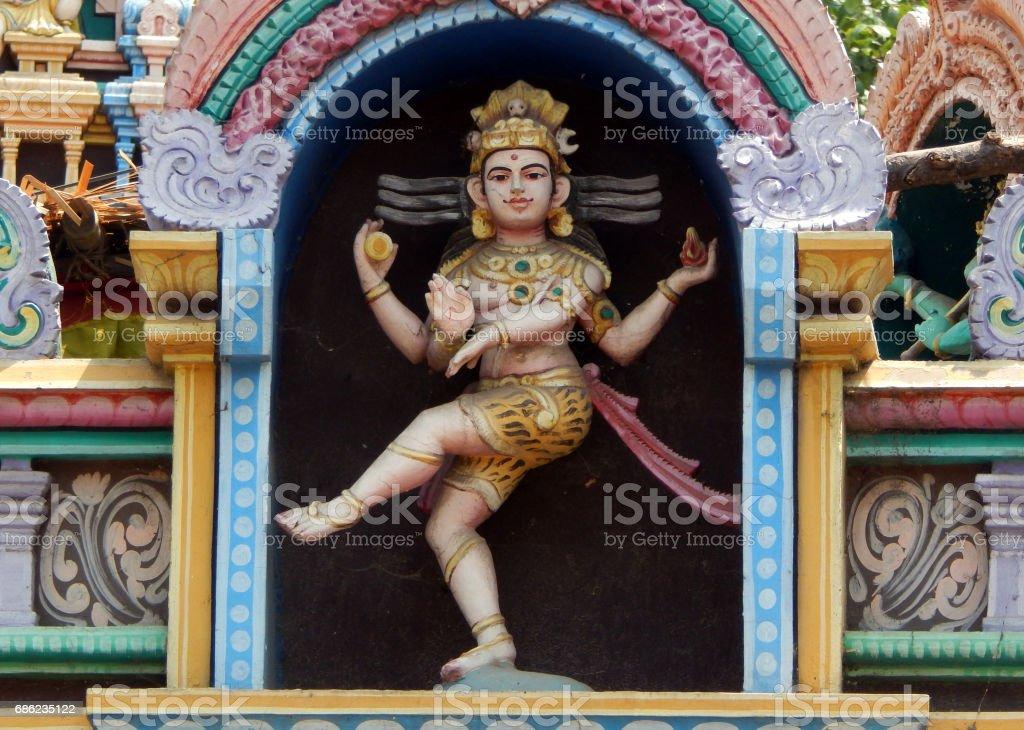 Architecture and Statute Hindu God Shiva in Dancing Nataraja form on exterior wall of Hindu Temple,Hyderabad,India stock photo