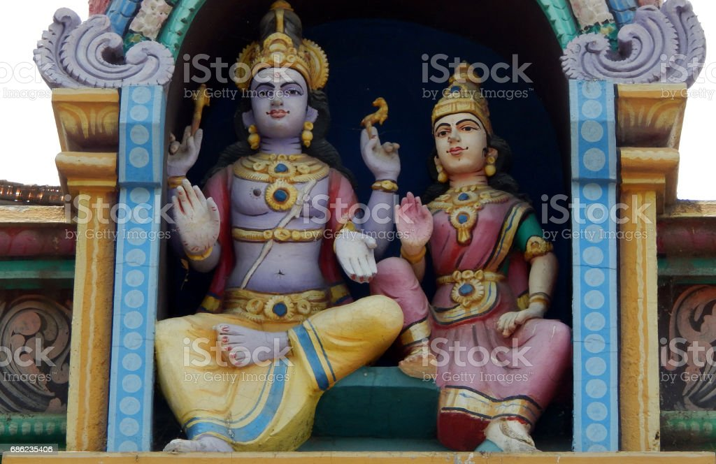 Architecture and statute of Hindu God Vioshnu and Godddess Lakshmi  on the wall exterior  of Temple,Hyderabad,India stock photo