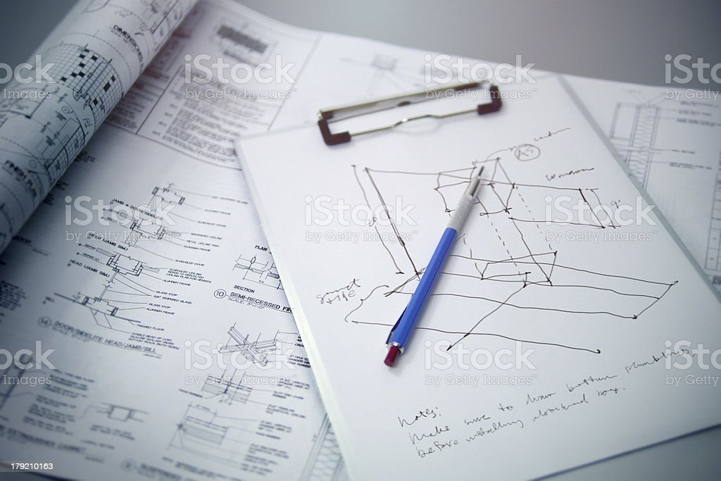 Architecture Blueprints with Pencil and Sketch on Clipboard royalty-free stock photo