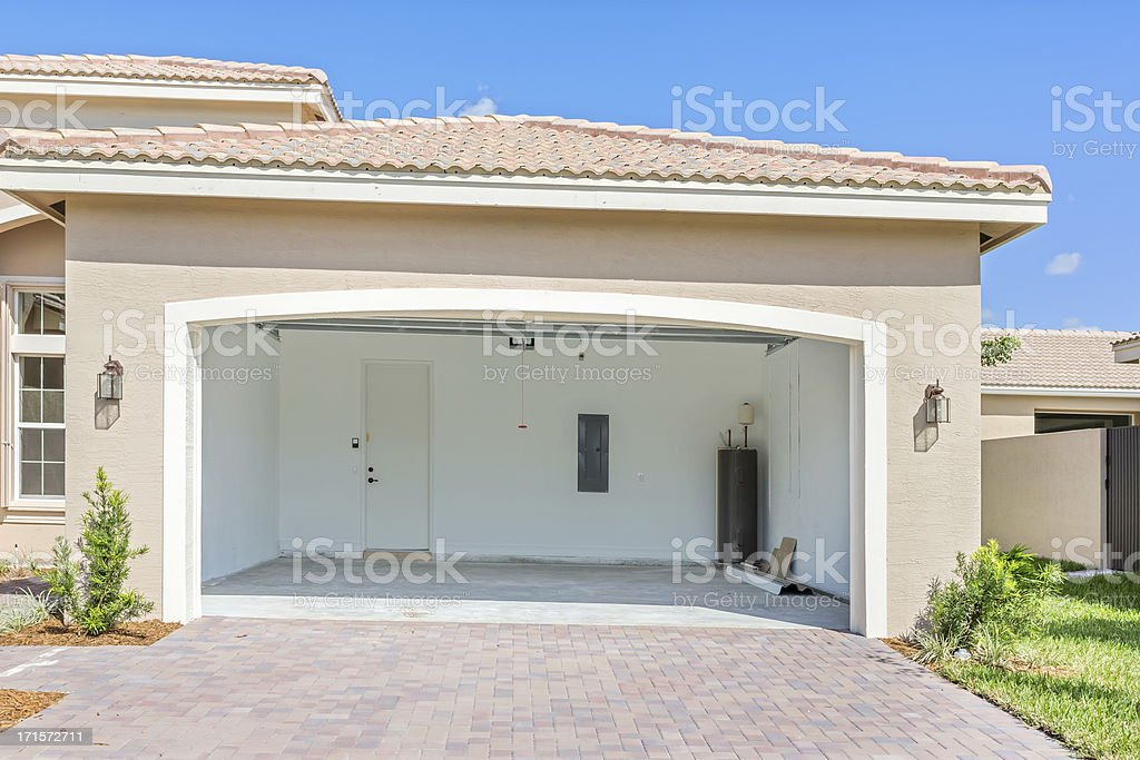 Architecture: Brand new house  being built with an empty garage stock photo