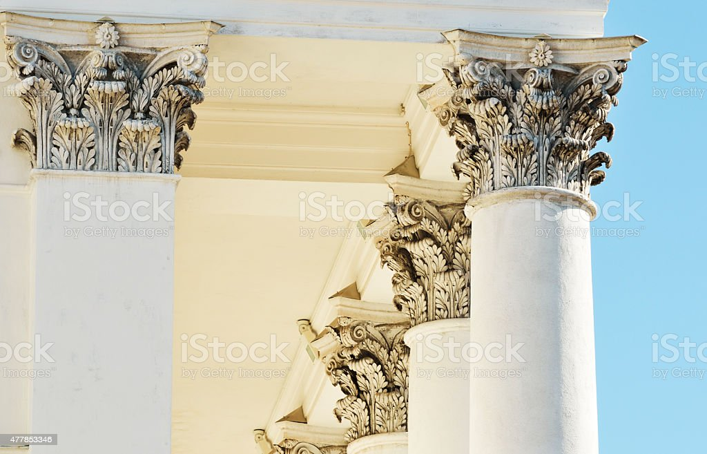 architecture, classical columns against blue sky stock photo
