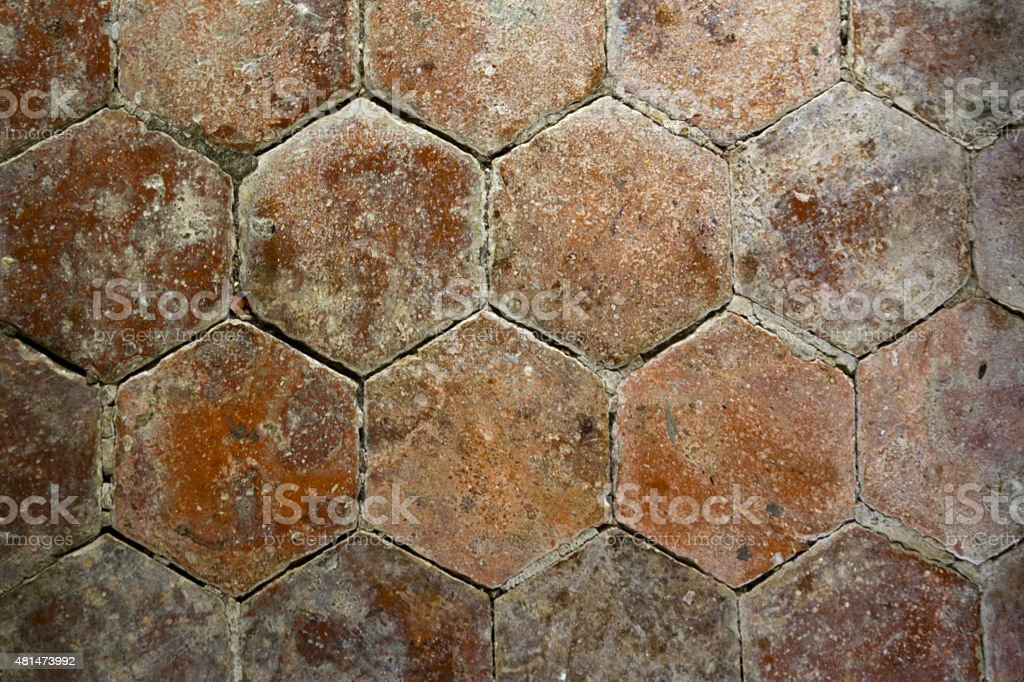 Architecture texture - Old distressed floor tiles. Six sided shape. stock photo