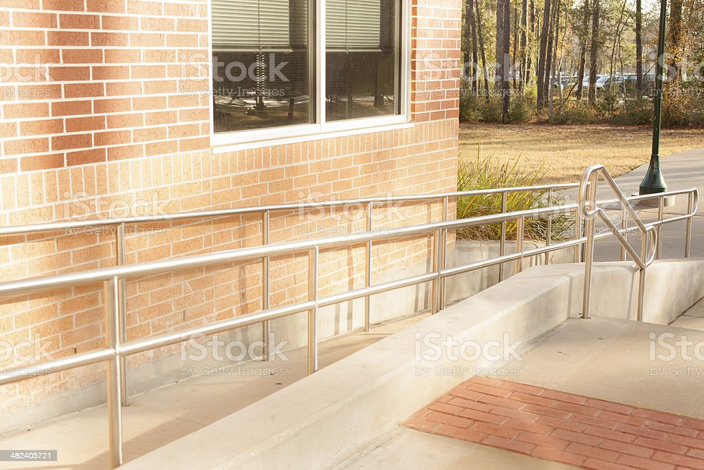 Architecture: Wheelchair ramp at business office or school campus. stock photo