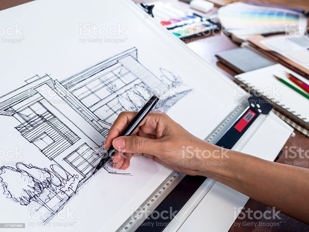 architecture working hard to draw a sketch of a modern house stock 1 credit