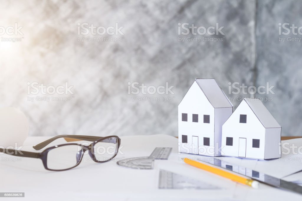 architecture workplace with building model and supplies stock photo