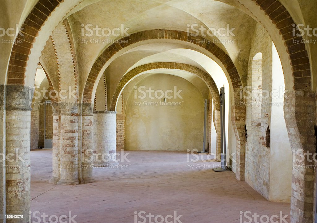 Archs in the Medieval Abbey of Morimondo, Milan, Italy royalty-free stock photo