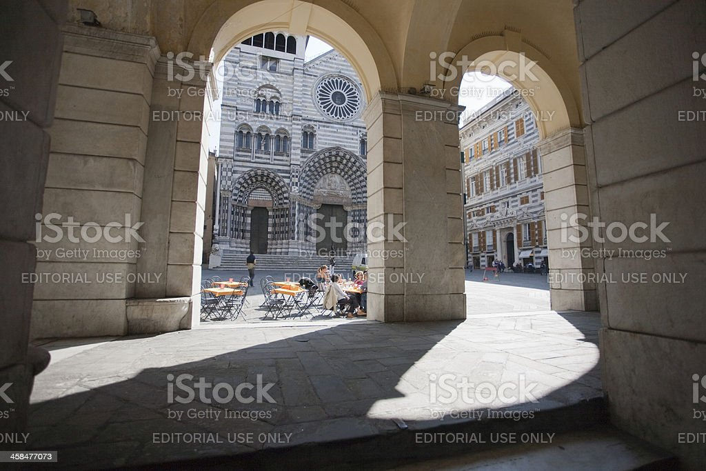 Archs with San Lorenzo cathedral in background royalty-free stock photo