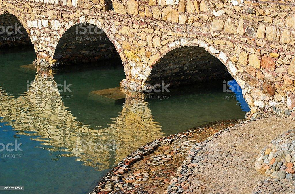 Arch-stone bridge stock photo