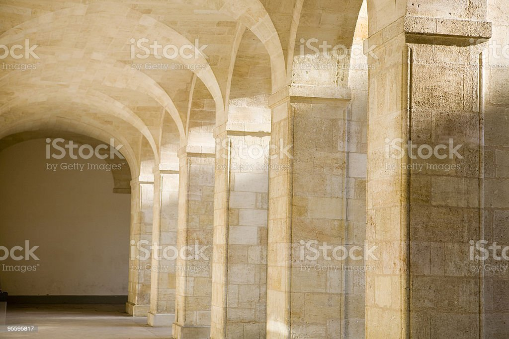 Archway focus on shadow and sunbeam royalty-free stock photo