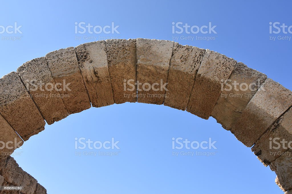Archway in ruins of Caesarea stock photo