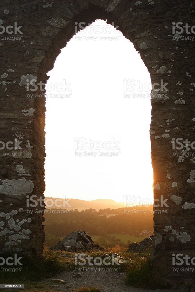 archway into the sun stock photo