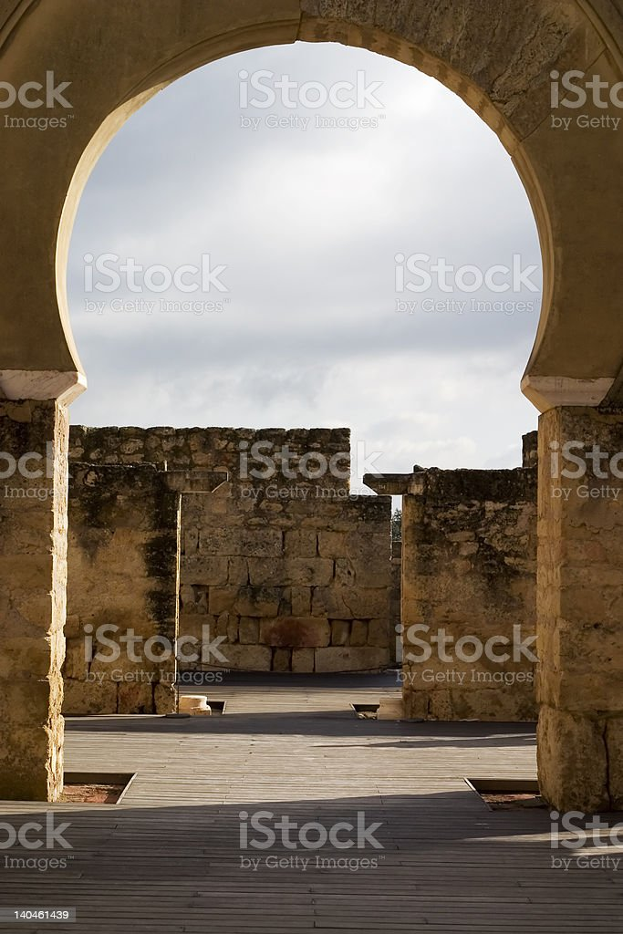 Archway revealing old walls and sky royalty-free stock photo