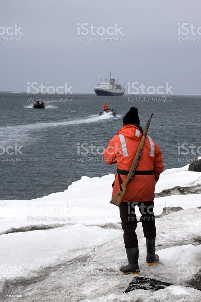Arctic Armed Tour Guide royalty-free stock photo