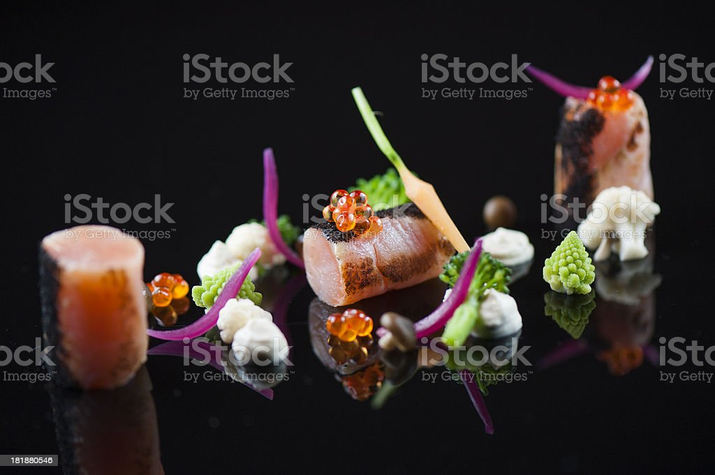 Arctic char with vegetables and salmon eggs royalty-free stock photo